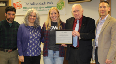 APA staff and Board Members present Certificate to Maddie